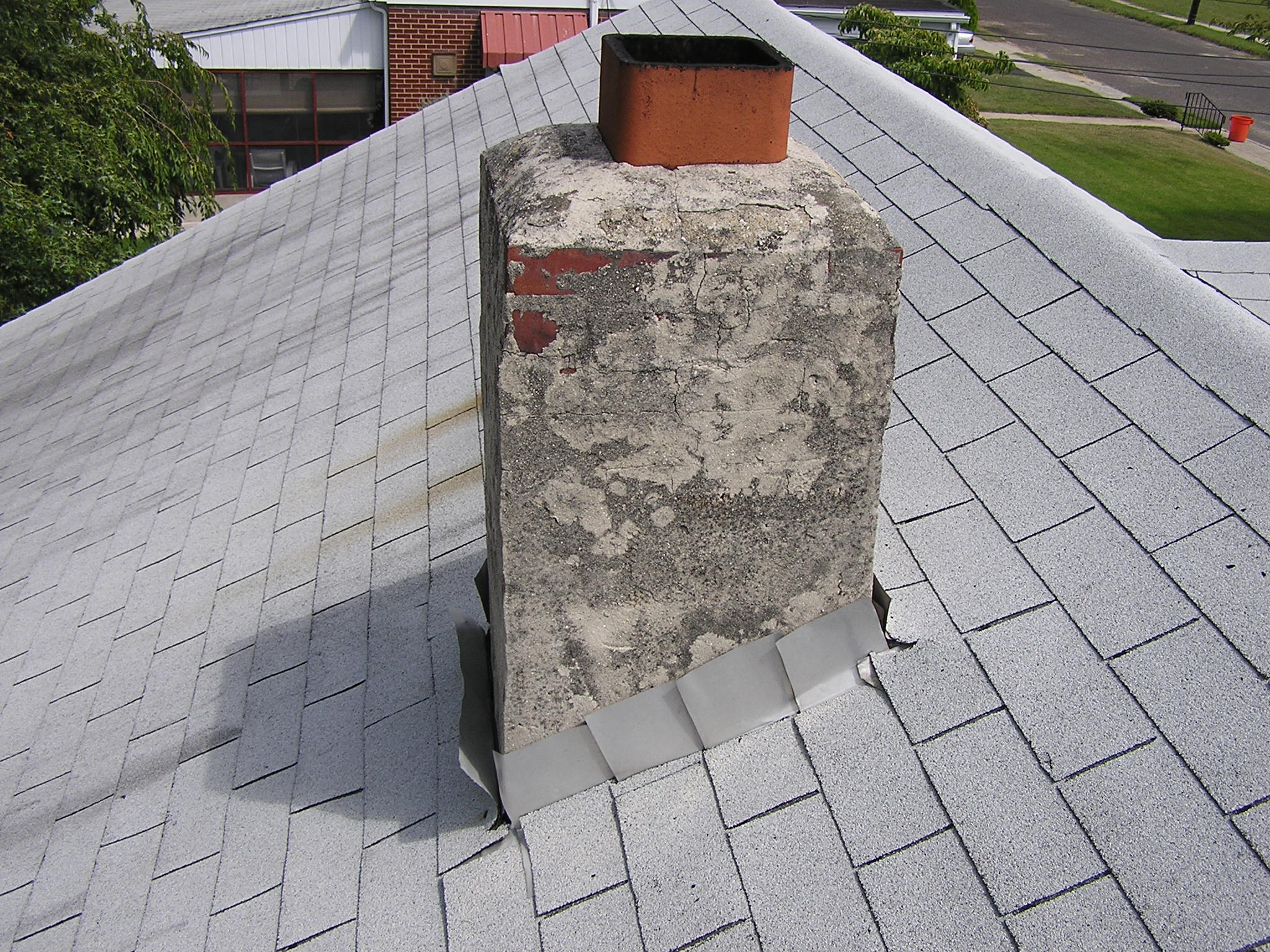 Chimney image - what is visible upon roof inspection.